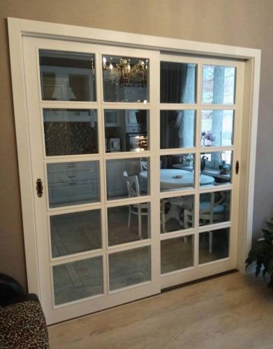 Раздвижные двери из массива со стеклом